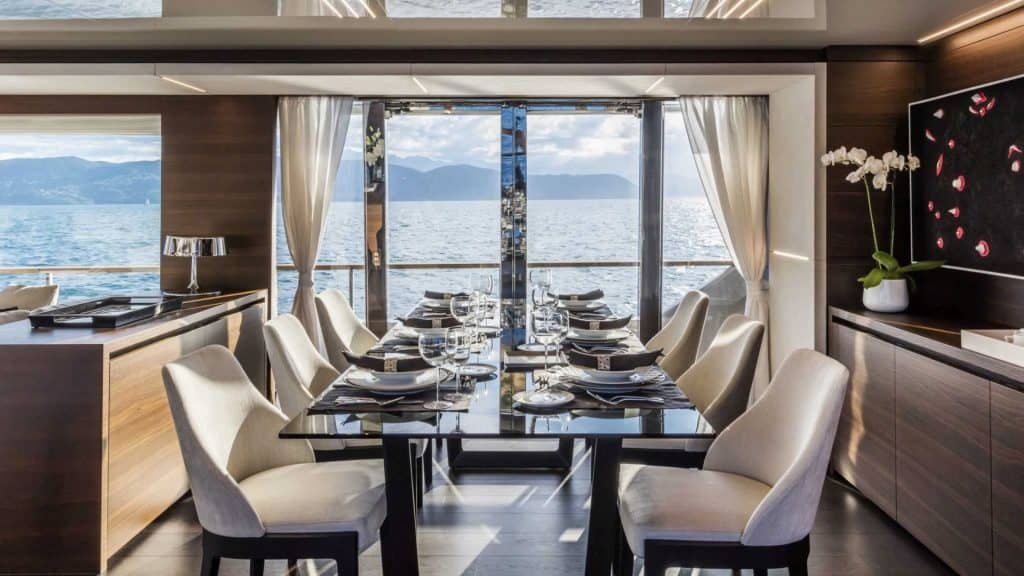 This is a photograph of a Custom Line Navetta 37 Dinner area 01